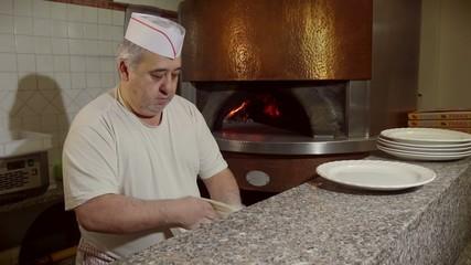 Man Cook Making Pizza In Italian Restaurant Kitchen Food