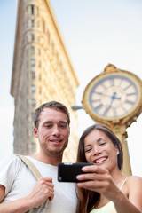 Travel couple taking selfie in NYC New York City