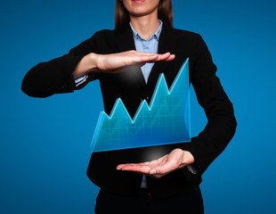 business woman - growth and success graph. Blue background