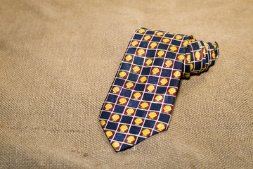 Folded  tie with a cheerful pattern on the old tissue