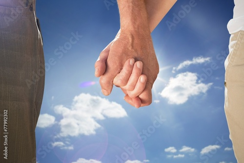 canvas print picture Composite image of happy senior couple holding hands