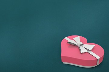 Pink coloured heart shape candy box