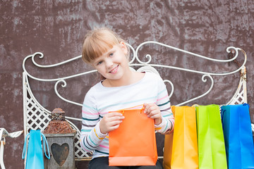 Smiling little  girl  after shopping