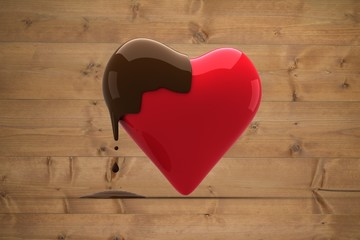 Composite image of heart dipped in chocolate