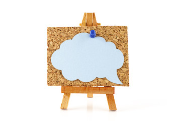 Wooden easel with cork board and blue speech bubble