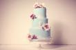 blue wedding cake with roses