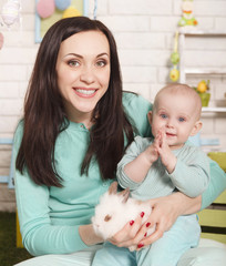 Mother and baby girl holding Easter rabbit