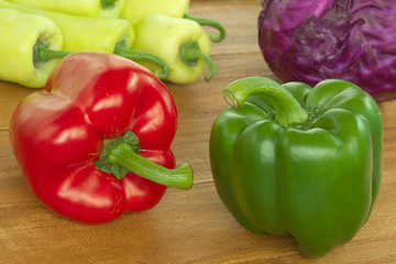 Red and Green bell pepper on wooden table