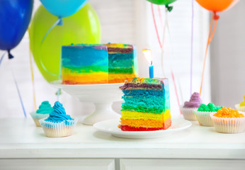 Rainbow cake decorated with birthday candle
