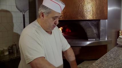 Man Working Cook Making Pizza In Italian Restaurant Kitchen