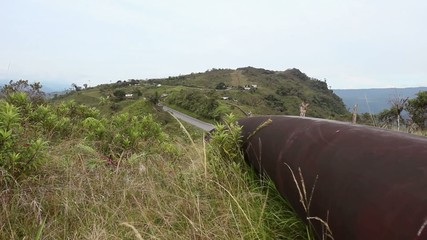 Oil pipeline running along an Andean ridge top in Ecuador