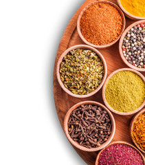 assorted spices in a wooden bowl