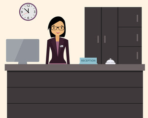 Happy female receptionist standing at hotel
