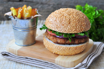 Closeup of home made burgers with the fried potato