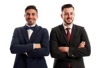 Confident and successful business men crossing arms