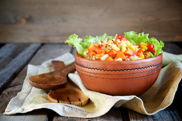 Salad with quinoa and vegetables in a ceramic bowl