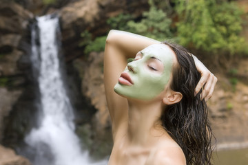 Woman with blue clay facial mask in beauty spa (Outdoor)