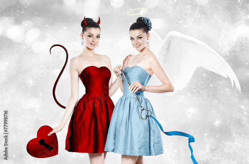 canvas print picture Beautiful young woman as devil and angel