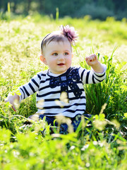baby in green grass