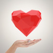 Low poly heart in hands.