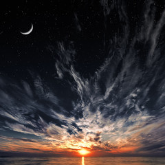 Beautiful sunset, moon and starry sky