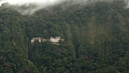 Waterfall on a vertical cliff in rainforest, Ecuador