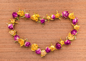 Beautiful greeting card of Valentine with dried roses on wooden
