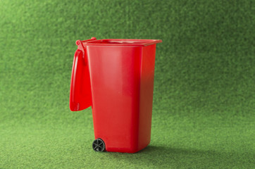 red open garbage bin container