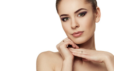 Tender female with beautiful evening make-up over white