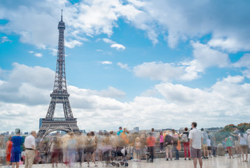 Mesmerized by Eiffel Tower, Paris. Moving tourists in Trocadero