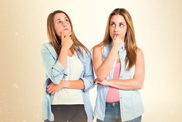 Girls thinking over isolated white background