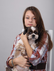 girl in a chair with a dog