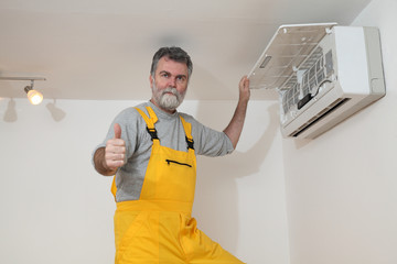 Air condition examine or install worker gesture, thumb up