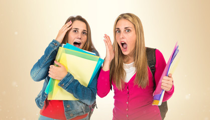 Student women doing surprise gesture over white background