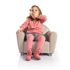 Surprised girl sitting on armchair