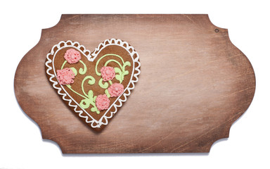 Ginger biscuits in the form of heart on a wooden  shaped board