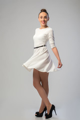 Beautiful girl dancing in white dress