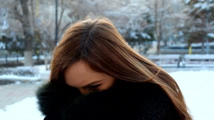 Young  smiling woman winter portrait. Full HD footage