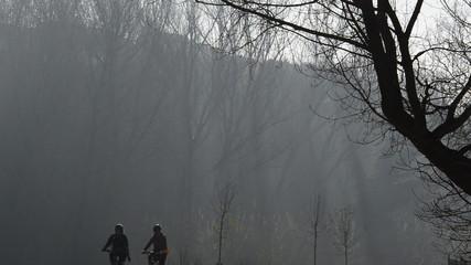 Two people doing sport bike in winter