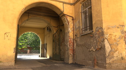 Old courtyard with arch in St. Petersburg. 4K.