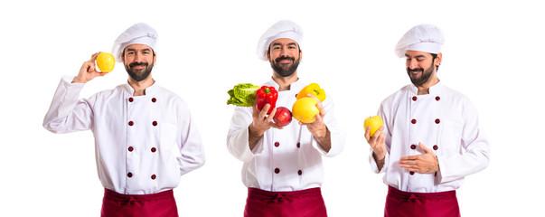 Chef holding vegetables