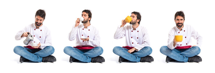 Chef drinking coffee over white background