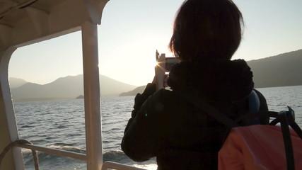 Photographer girl taking outside view handheld shot