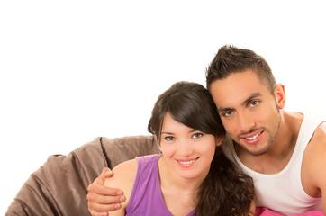 sweet latin couple smiling wearing their pijamas
