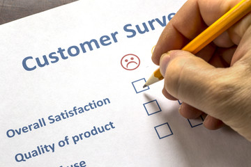 Man completing a customer survey