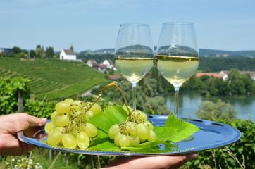 Wine and grapes against vineyards in Rheinau, Switzerland