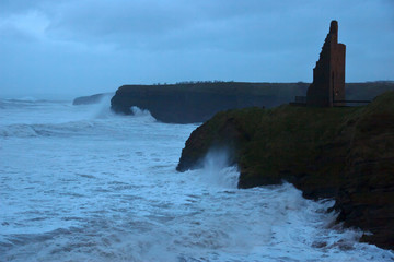storm waves at Ballybunion castle and cliffs
