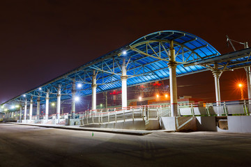 platform on the railway station at night