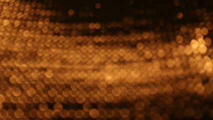 Dolly shot of golden bokeh background
