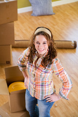 Moving: Smiling Woman Standing By Packing Boxes